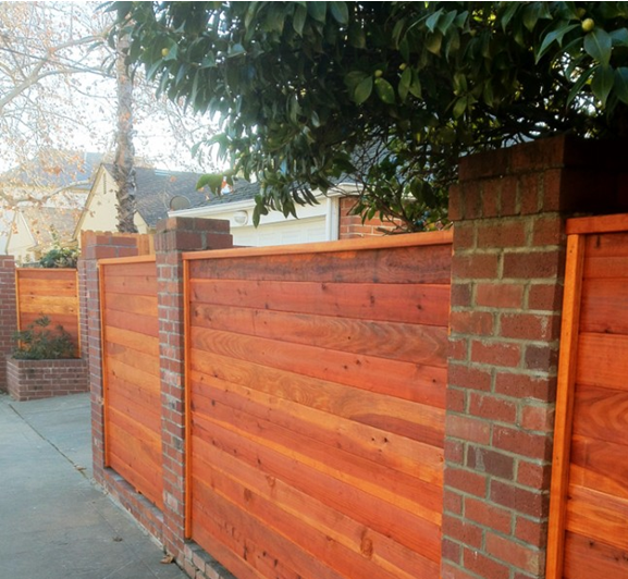 ServiceLane Brick And Wood Fencing